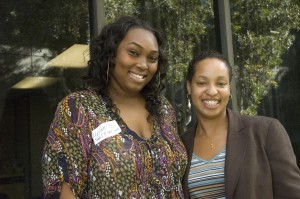 Dr. Tiffany Herbert (at right) and junior Brittany Ball welcome the new Sisters United cohort for fall
