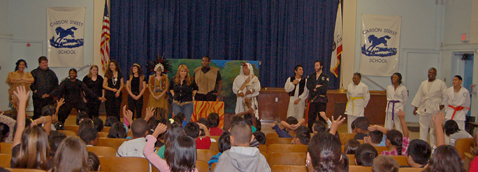 Elementary school students are entertained and enlightened by Teatro Dominguez's multicultural fables at Carson Street School