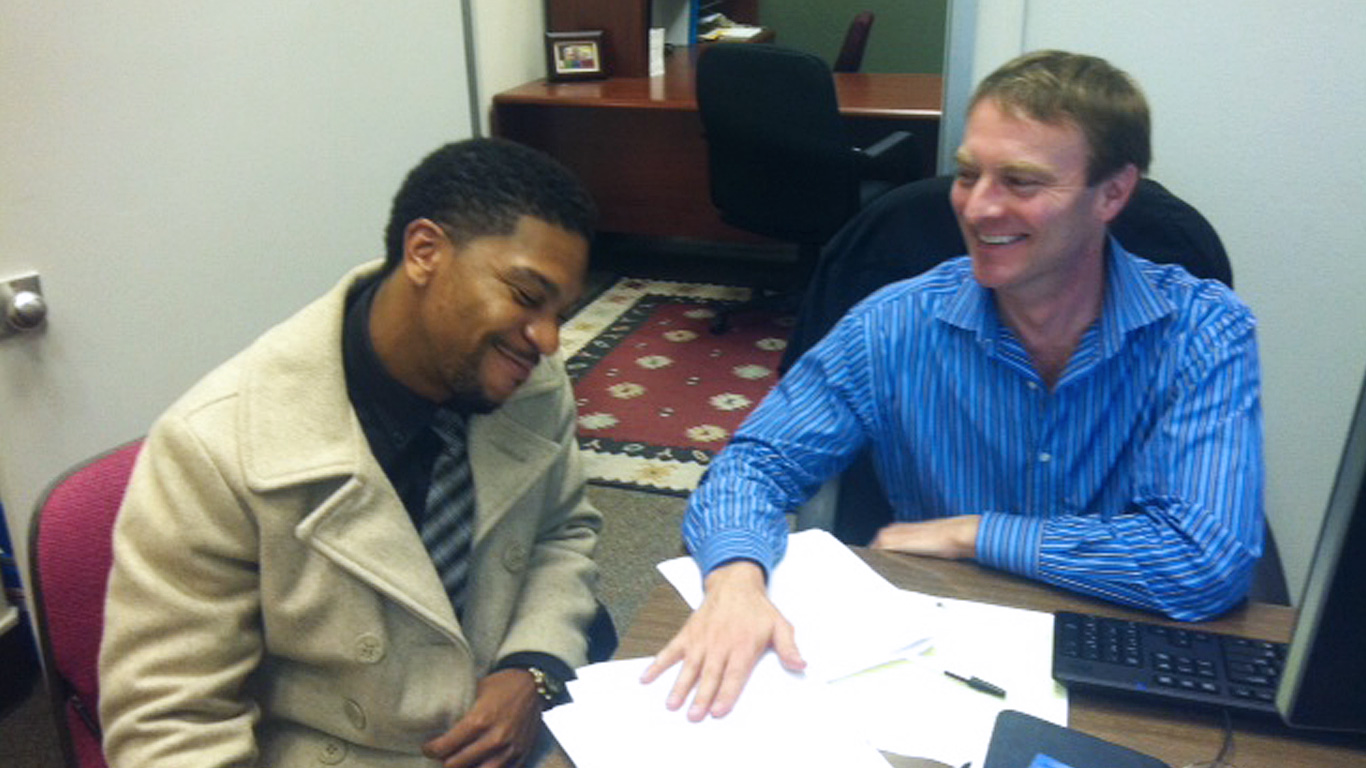 Matt Mutchler works with student at the Urban Community Research Cente