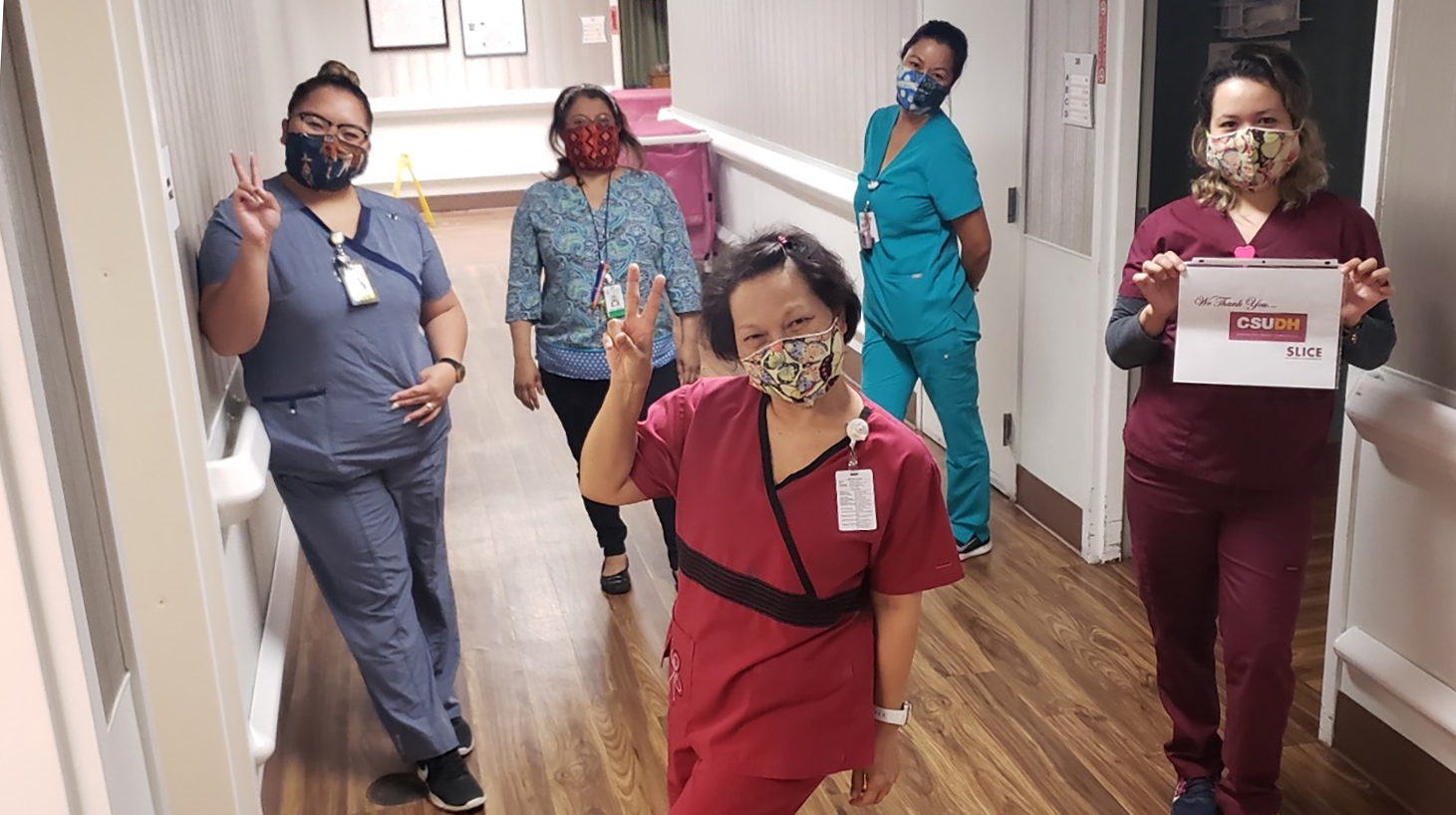 Health care professionals at Rosecrans Care Center in Gardena wear face masks donated by SLICE.